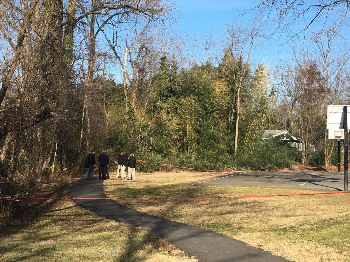 Fairfax County police in Woodlawn Park in Alexandria after a body was found there Friday morning. (Courtesy Fairfax County police)