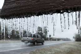 """Icicles hang from the """"Welcome to Hilliard sign"""" in Hilliard, Fla., Wednesday, Jan. 3, 2018. A brutal winter storm scattered a wintry mix of snow, sleet and freezing rain from normally balmy Florida up the Southeast seaboard Wednesday. (Bob Self/The Florida Times-Union via AP)"""