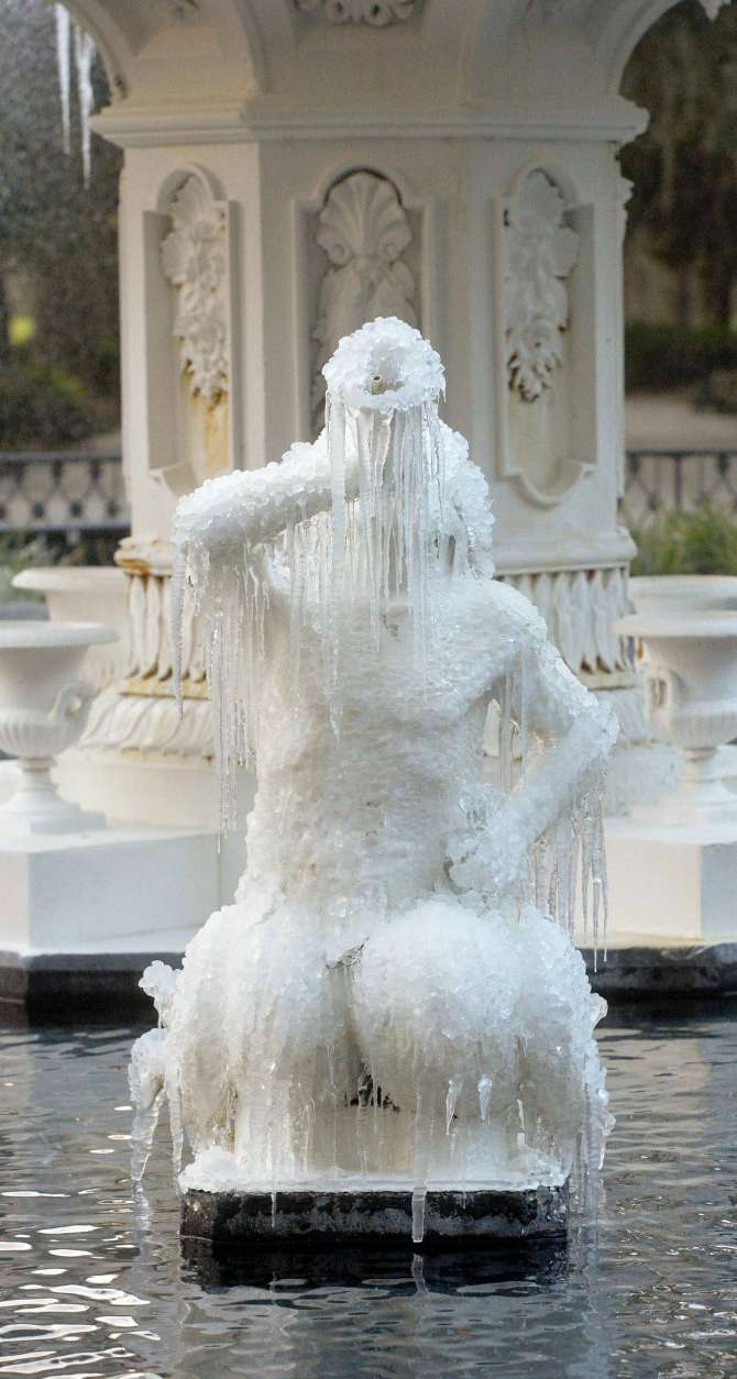 Icicles form on the tritons in the Forsyth Park Fountain Tuesday morning, Jan. 2, 2018, in Savannah, Ga.  Savannah is shivering through a rare bout with icy weather, with the National Weather Service predicting that up to 2 inches of snow and sleet could fall Wednesday on the typically balmy coastal city. (Steve Bisson/Savannah Morning News via AP)