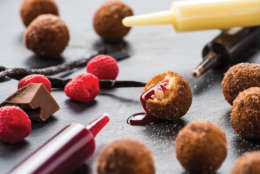 The Injectable Donut Holes include chocolate, raspberry and Bavarian cream fillings. (Courtesy: Topgolf)