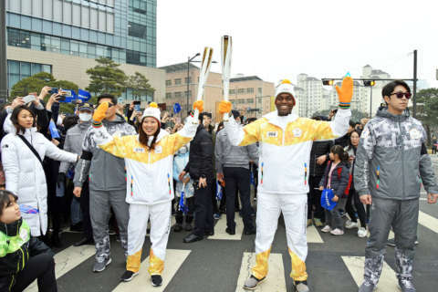 WTOP's Suann Lee carries Olympic torch