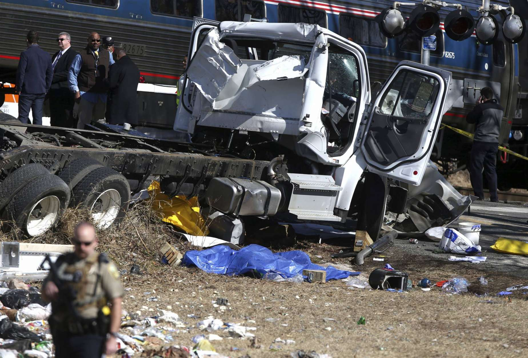 Wreckage is seen near the scene of where an Amtrak train carrying multiple Republican lawmakers crashed into a garbage truck  in Crozet, Va., on Wednesday, Jan. 31, 2018.  A chartered train carrying dozens of GOP lawmakers to a Republican policy retreat in West Virginia struck a garbage truck in a rural Virginia town Wednesday.  (Zack Wajsgras/The Daily Progress via AP)