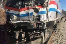 This photo provided by Rep. Jeff Denham shows the damage to the front of a train after crashing into a garbage truck in Crozet, Va., on Wednesday, Jan. 31, 2018.  The Amtrak passenger train carrying dozens of GOP lawmakers to a Republican retreat in West Virginia struck a garbage truck south of Charlottesville, Va. No lawmakers were believed injured. (Jeff Denham via AP)