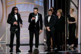 "BEVERLY HILLS, CA - JANUARY 07: In this handout photo provided by NBCUniversal, James Franco, with Tommy Wiseau and Dave Franco, accepts the award for Best Performance by an Actor in a Motion Picture – Musical or Comedy for ""The Disaster Artist"" during the 75th Annual Golden Globe Awards at The Beverly Hilton Hotel on January 7, 2018 in Beverly Hills, California. (Photo by Paul Drinkwater/NBCUniversal via Getty Images)"