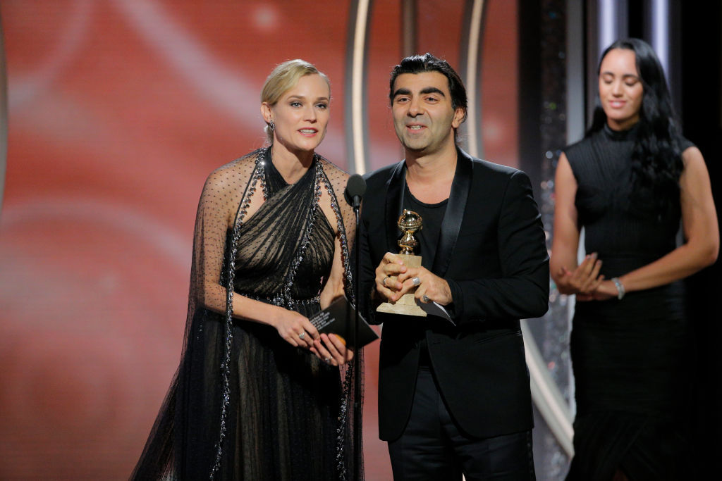 BEVERLY HILLS, CA - JANUARY 07:  In this handout photo provided by NBCUniversal,  Director Fatih Akin, with actress Diane Kruger,   accepts the award for Best Motion Picture ? Foreign Language for ?In the Fade?  during the 75th Annual Golden Globe Awards at The Beverly Hilton Hotel on January 7, 2018 in Beverly Hills, California.  (Photo by Paul Drinkwater/NBCUniversal via Getty Images)