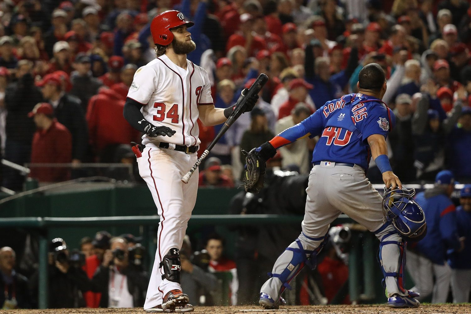 WASHINGTON, DC - OCTOBER 13: Bryce Harper #34 of the Washington Nationals strikes out for the final out of the game against the Chicago Cubs in game five of the National League Division Series at Nationals Park on October 13, 2017 in Washington, DC. (Photo by Patrick Smith/Getty Images)