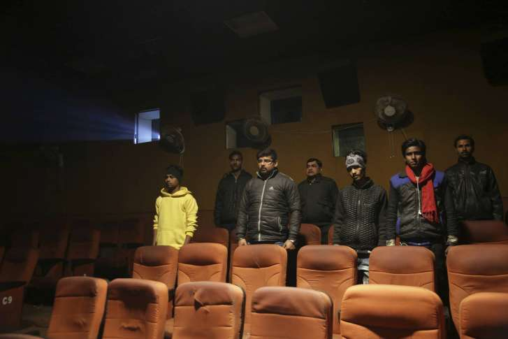 Supreme court theaters do not have to play indian anthem wtop indian moviegoers stand up as national anthem is played at a cinema before the screening of a movie in allahabad india tuesday jan 9 2018 altavistaventures Images