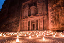 When visiting Jordan it is a must to go to Petra, when in Petra it is a must to take the Petra by night tour through the Siq to the Treasury temple. Along the path several kilometers long the organizers light more than 2000 candles. This provide the only illumination other than that of the stars and constant strobes of tourist cameras.