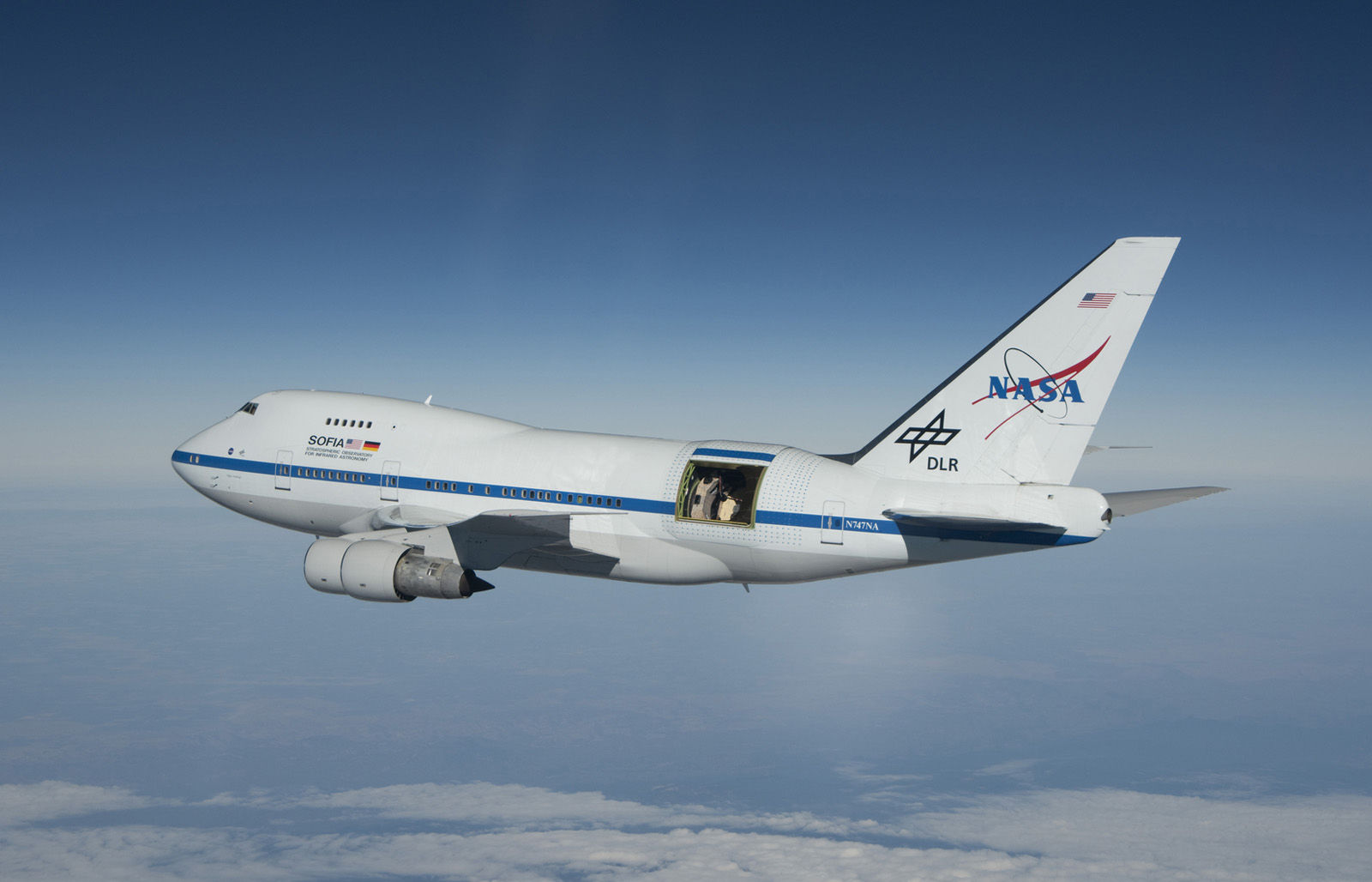 With the large door over its 2.5-meter German-built telescope wide open, NASA's Stratospheric Observatory for Infrared Astronomy 747SP aircraft soars over Southern California's high desert. SOFIA makes astronomical observations between 39,000 and 45,000 feet altitude, typically flying 10 hours per flight. (Courtesy NASA/USRA)