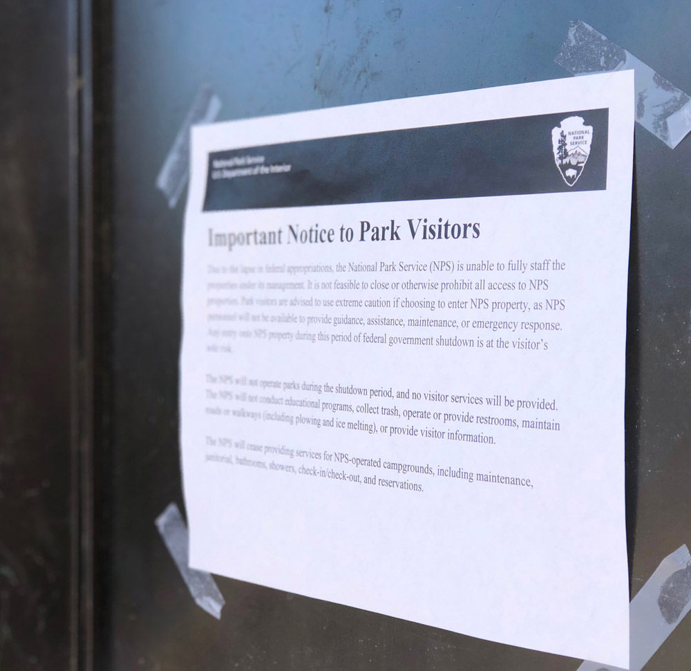 A sign at the Lincoln Memorial during a brief government shutdown in January 2018 informs visitors that National Park Service is unable to staff or maintain NPS properties. (WTOP/Kate Ryan)