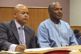 FILE - In this July, 20, 2017, file pool photo, former NFL football star O.J. Simpson appears with his attorney Malcolm LaVergne, left, during a parole hearing at the Lovelock Correctional Center in Lovelock, Nev. LaVergne said Thursday, Jan. 18, 2017, the 70-year-old former football hero and armed robbery convict is playing lots of golf and has not filed paperwork to move to a different state. Simpson is living in a friend's five-bedroom home several miles from the Las Vegas Strip. (Jason Bean/The Reno Gazette-Journal via AP, Pool, File)