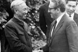 Presidential adviser Dr. Henry Kissinger and Hanoi's Le Duc Tho, left, shake hands after conferring in suburban St. Nom La Breteche, June 12, 1973.  They have yet to finalize their draft accord to tighten the Vietnam peace agreement.  At far right is Le Duc Tho's aide Nguyen Co Thach.  (AP Photo/Michel Lipchitz)