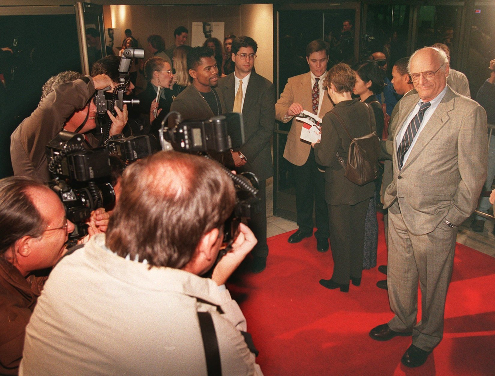 "Playwrite Arthur Miller, right, poses for photographers as he arrives for the premiere of the ""The Crucible,"" in Beverly Hills, Calif., Wednesday, Nov 20, 1996.  ""The Crucible,"" which is based on one of Millers plays, is stars Daniel Day-Lewis and Winona Ryder, and produced by Millers son Robert A. Miller.(AP Photo/ Frank Wiese)"