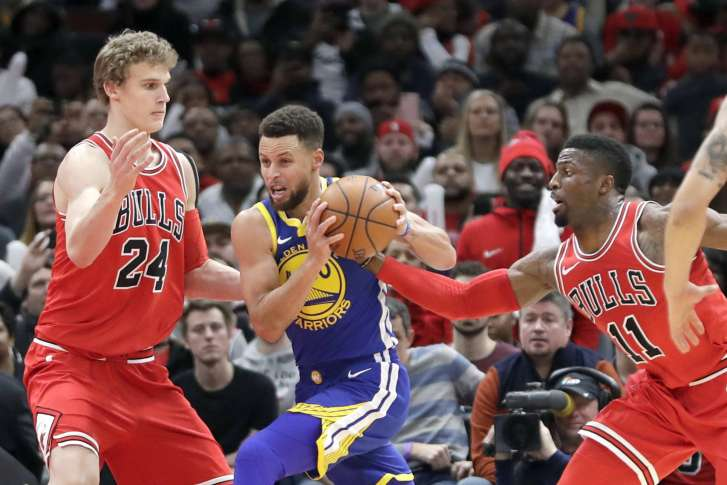 bd396a711a1 Chicago Bulls  David Nwaba (11) steals the ball from Golden State Warriors  Stephen  Curry (30) as Lauri Markkanen also defends during the second half of an ...