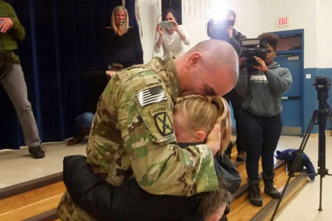 Tearful homecoming: Deployed Army dad surprises daughter at Va. school