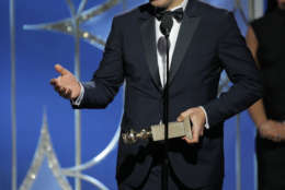"""BEVERLY HILLS, CA - JANUARY 07:  In this handout photo provided by NBCUniversal,  Alexandre Desplat accepts the award for Best Original Score – Motion Picture for """"The Shape of Water"""" during the 75th Annual Golden Globe Awards at The Beverly Hilton Hotel on January 7, 2018 in Beverly Hills, California.  (Photo by Paul Drinkwater/NBCUniversal via Getty Images)"""