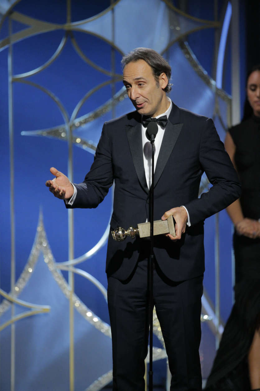 "BEVERLY HILLS, CA - JANUARY 07:  In this handout photo provided by NBCUniversal,  Alexandre Desplat accepts the award for Best Original Score – Motion Picture for ""The Shape of Water"" during the 75th Annual Golden Globe Awards at The Beverly Hilton Hotel on January 7, 2018 in Beverly Hills, California.  (Photo by Paul Drinkwater/NBCUniversal via Getty Images)"