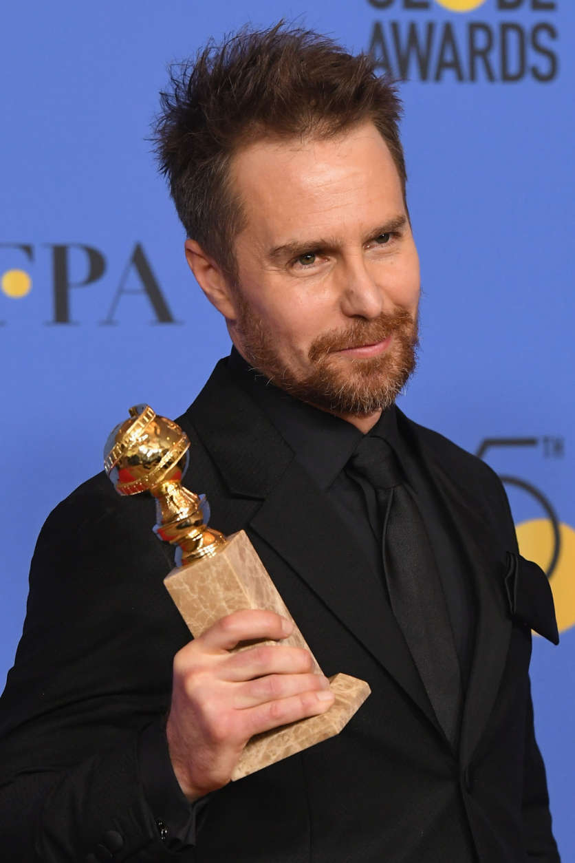 Actor Sam Rockwell holds his award for Best Performance by an Actor in a Supporting Role in any Motion Picture in the press room during The 75th Annual Golden Globe Awards at The Beverly Hilton Hotel on January 7, 2018 in Beverly Hills, California.  (Photo by Kevin Winter/Getty Images)