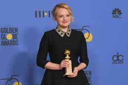Producer Elisabeth Moss of 'The Handmaid's Tale' poses with the award for Best Television Series Drama in the press room during The 75th Annual Golden Globe Awards at The Beverly Hilton Hotel on January 7, 2018 in Beverly Hills, California.  (Photo by Kevin Winter/Getty Images)