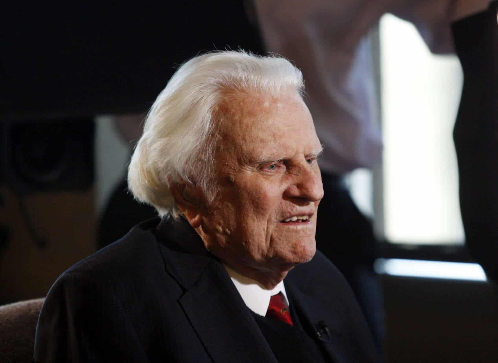 FILE- In this Dec. 20, 2010 file photo, evangelist Billy Graham, 92, is interviewed at the Billy Graham Evangelistic Association headquarters in Charlotte, N.C. A spokesman said Graham died at his home in North Carolina on Feb. 21, 2018. He was 99. Graham was treated for numerous ailments late in life. He was known for counseling many U.S. presidents. (AP Photo/Nell Redmond, File)