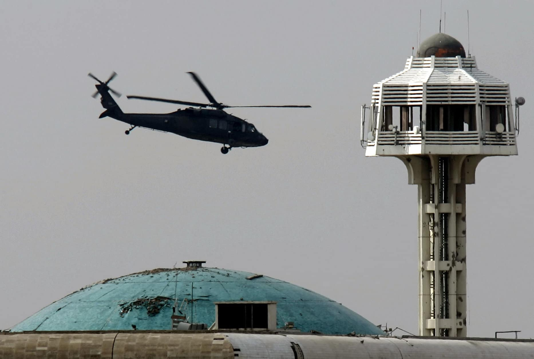 A U.S. Army Black Hawk helicopter flies over Baghdad's heavily fortified Green Zone, Iraq, Wednesday, Feb. 7, 2007. The U.S. military said it was investigating reports that an aircraft went down Wednesday and the reports came five days after a U.S. Army helicopter crashed in a hail of gunfire north of Baghdad, - the fourth helicopter lost in Iraq in a two-week span. (AP Photo/Marko Drobnjakovic)