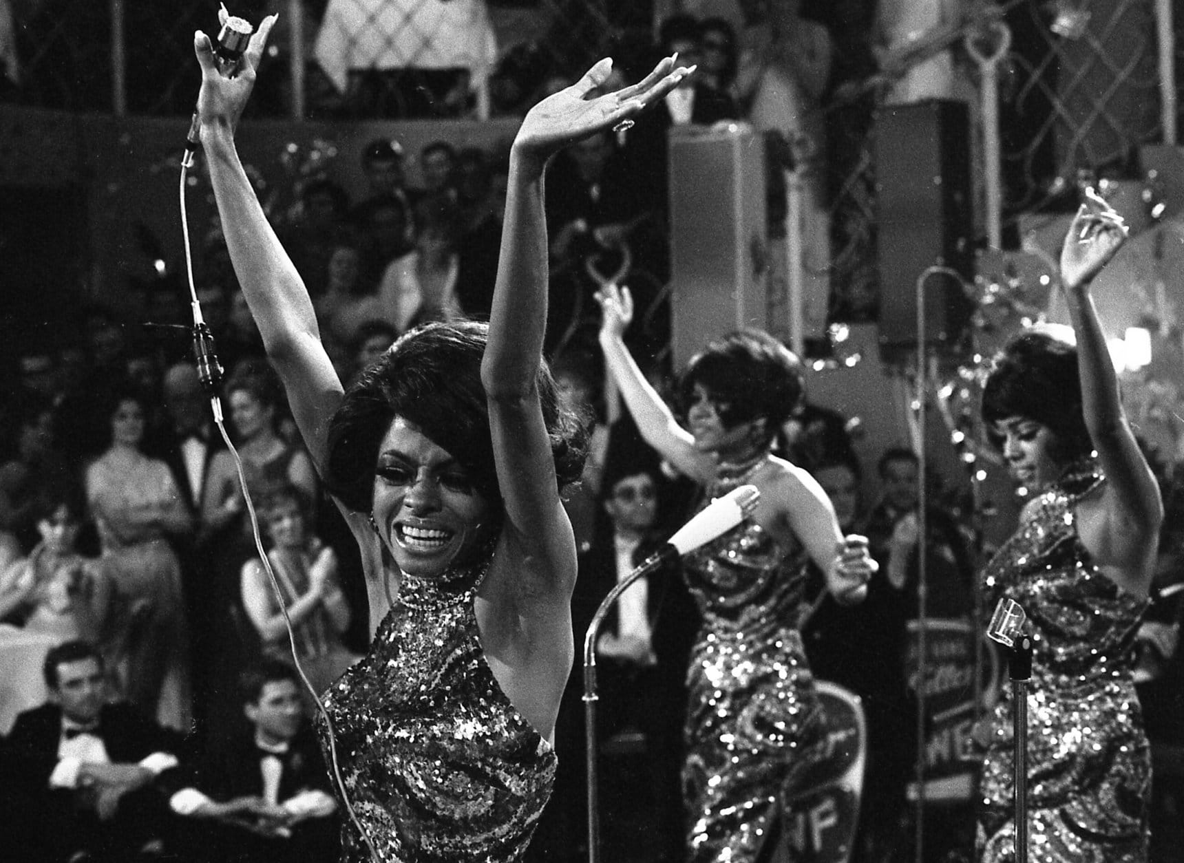 """FILE -In this Jan. 21, 1968 file photo, The Supremes with Diana Ross, front, Cindy Birdsong and Mary Wilson dance with their arms in the air as they perform at the annual """"Bal pare"""" party in Munich, West Germany. Ross, Wilson and the Florence Ballard made up the first successful configuration of the group. Cindy Birdsong replaced Ballard in 1967. Wilson, now 70, reminisced in an interview with Associated Press on June 12, 2014, about a major milestone: the 50th anniversary of the Supremes first No. 1, million-selling song, """"Where Did Our Love Go"""" - released June 17, 1964.  (AP Photo/Klaus Frings, file)"""