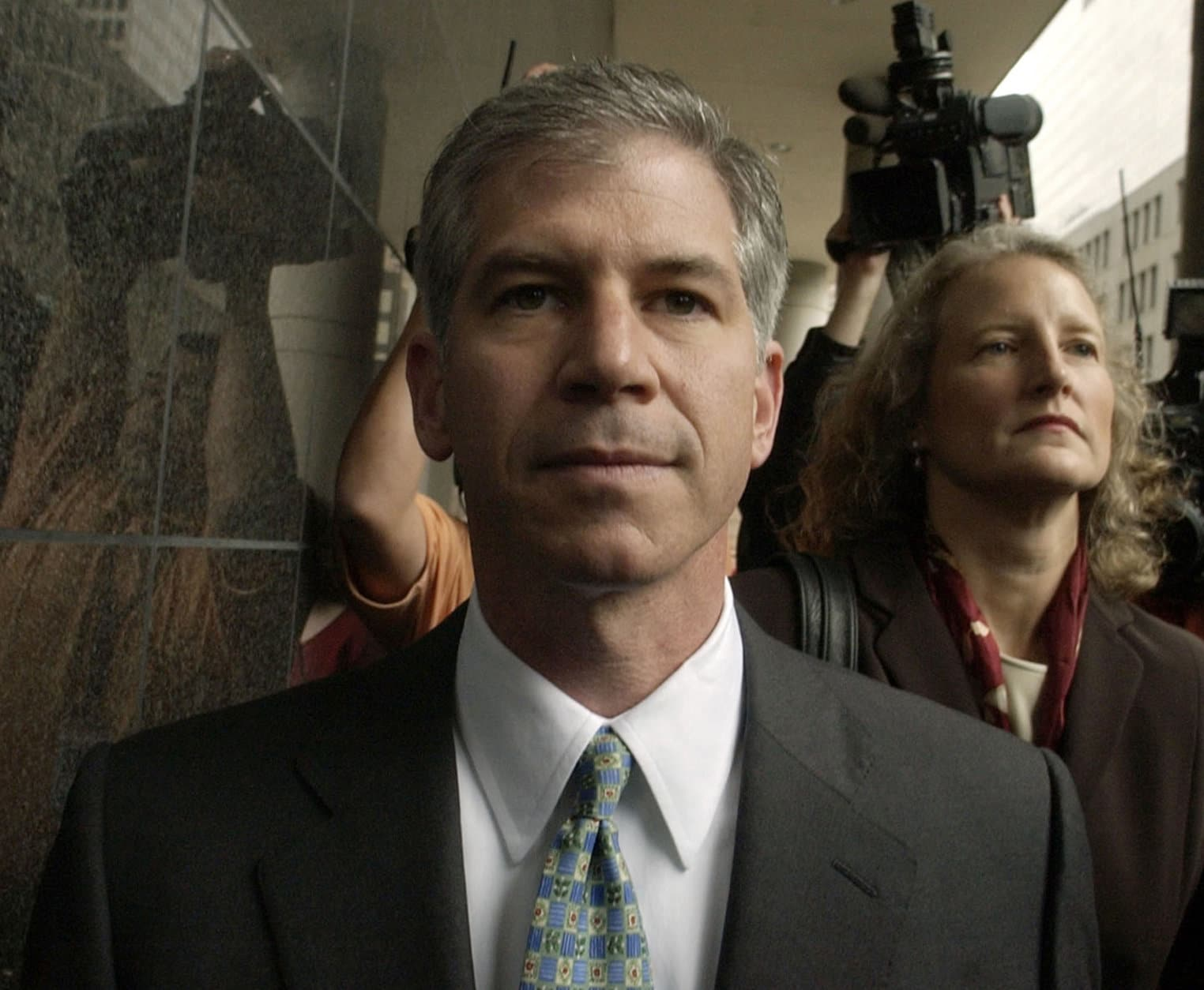 FILE - In this Jan. 14, 2004, file photo former Enron finance chief Andrew Fastow, center, arrives for court in Houston with his attorney Jan Little. The Federal Bureau of Prisons website shows Fastow was moved from a Pollack, La., prison to a low-security community corrections facility in Houston. Fastow is considered the mastermind behind the financial schemes that doomed Enron. (AP Photo/David J. Phillip, file)