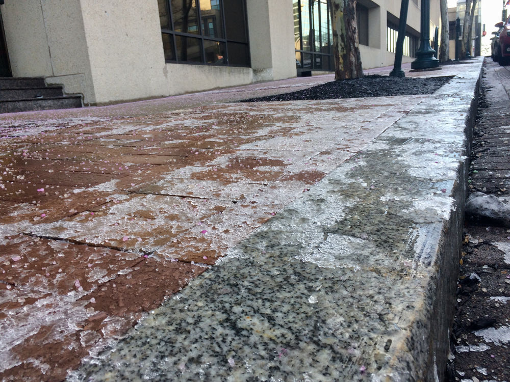 Ice coats the sidewalk in Rockville, Maryland, in January 2018. (WTOP/Nick Iannelli)