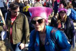 Marchers donned pink hats and carried signs at the 2018 Women's March in D.C. on Saturday. (WTOP/Kathy Stewart)