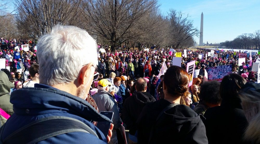 Marchers gathered at the Reflecting Pool during the Women's March in D.C. on Saturday. (WTOP/Kathy Stewart)