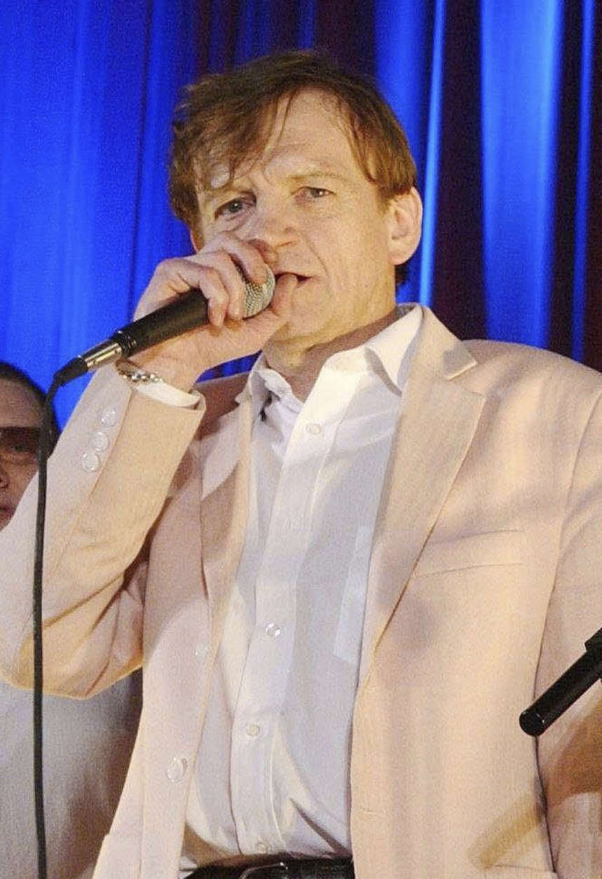 FILE - This is a June 16, 2005 file  photo of  Mark E Smith the  lead singer and driving force of British post-punk band The Fall, has died aged 60 at home on Wednesday Jan. 24, 2018. (Yui Mok/PA, File via AP)