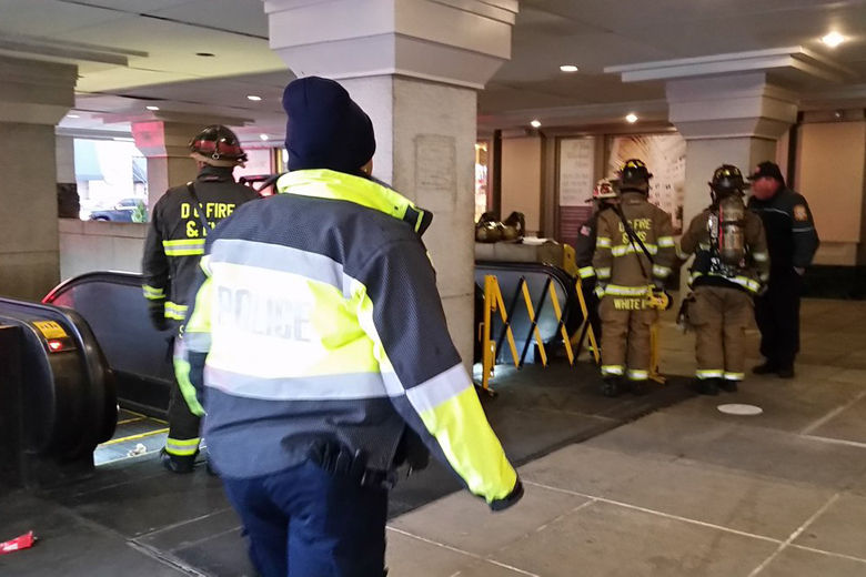 Photo shows firefighters at Metro Center
