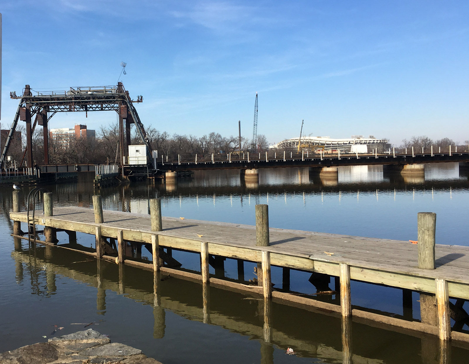 A railroad bridge crosses the Anacostia River near DC General homeless shelter and RFK Stadium in this Jan. 26, 2018 photo. D.C. police searched this stretch of river, including under the bridge, for any evidence related to the disappearance of Relisha Rudd. The 8-year-old girl was last seen alive in March 2014. (WTOP/Mike Murillo)