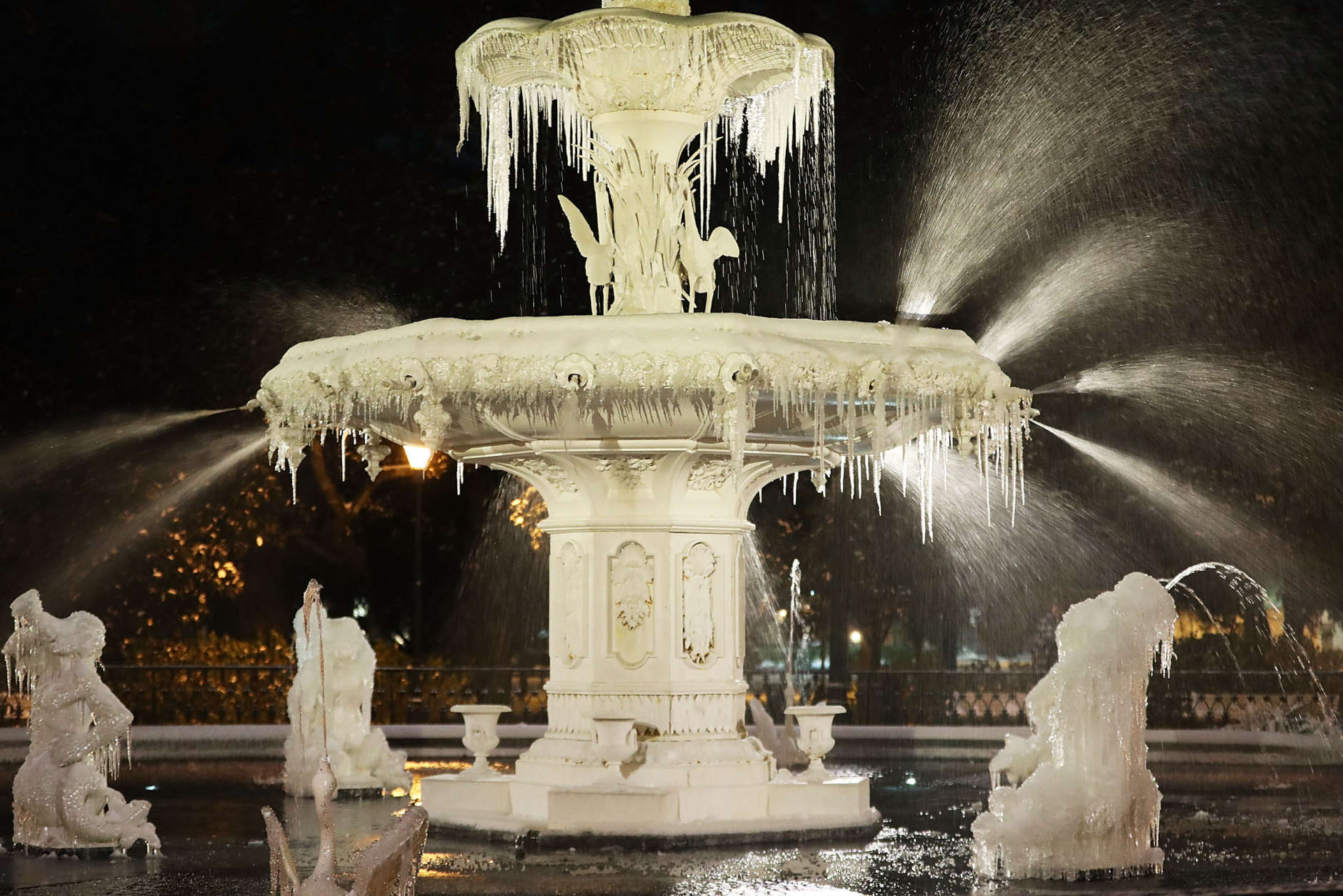 SAVANNAH, GA - JANUARY 04:  Ice forms on the water fountain in Forsyth Park as snow and cold weather blanket the area on January 4, 2018 in Savannah, Georgia. The extreme winter storm pummeled the Southeastern United States and is moving towards the east coast with frigid temperatures and heavy wind and snow.  (Photo by Joe Raedle/Getty Images)