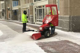 WTOP's Steve Dresner was in Boston Thursday and captured a photo of workers plowing snow from the sidewalks. (WTOP/Steve Dresner)