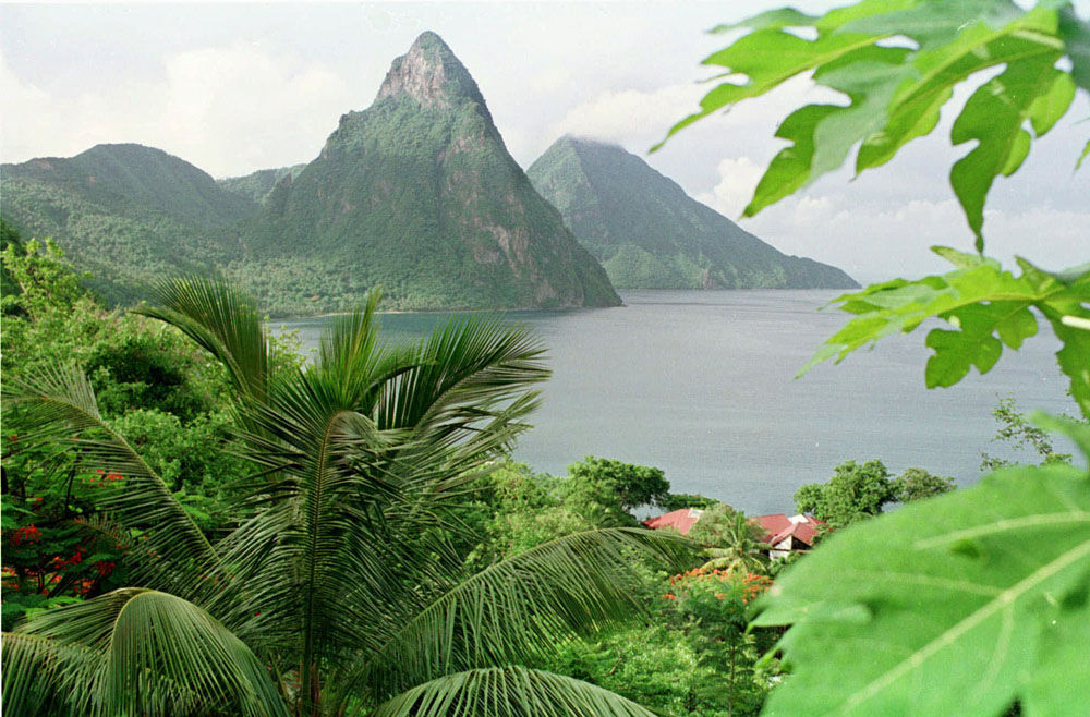 The Pitons, two large peaks that are the cone remnants of long-dormant volcanos, are shown on the Caribbean island of St. Lucia July 3, 1998. The Pitons can be found on the island flag, the the local beer bears their name. (AP Photo/Scott Sady)