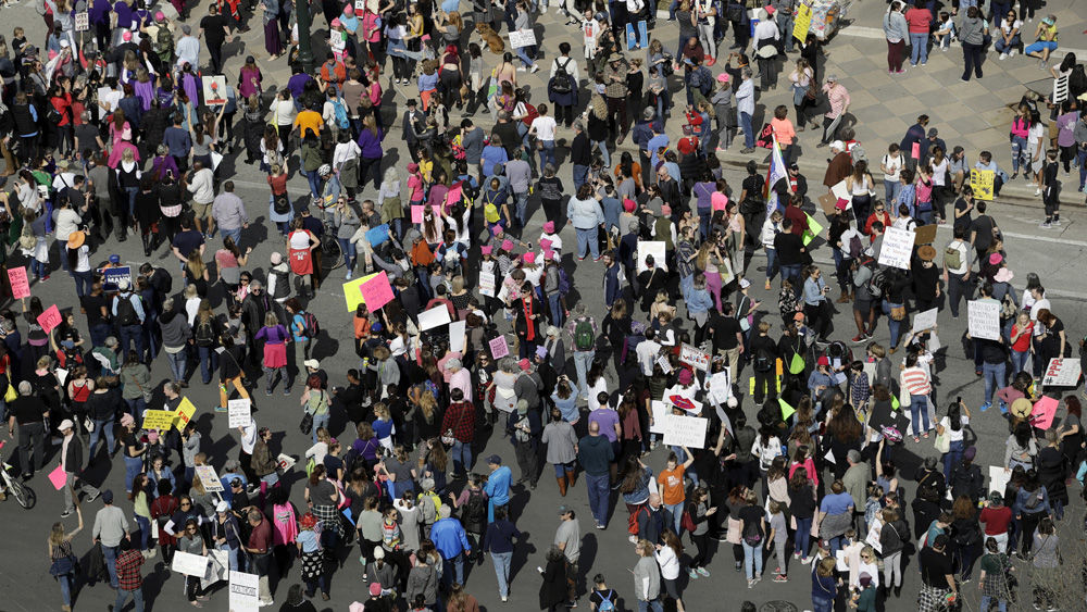 A women's march moves toward the Texas State Capitol on the one-year anniversary of President Donald Trump's inauguration, Saturday, Jan. 20, 2018, in Austin, Texas. (AP Photo/Eric Gay)