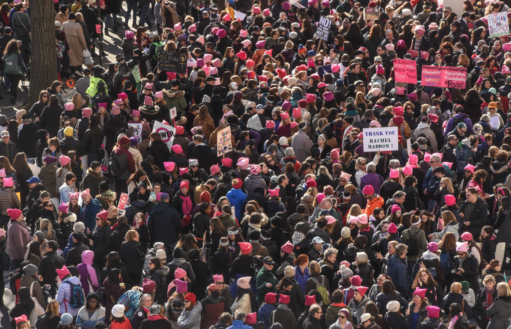 People gather near Central Park before the beginning of the Women's March on January 20, 2018 in New York City. Across the nation hundreds of thousands of people are marching on what is the one-year anniversary of President Donald Trump's swearing-in to protest against his past statements on women and to celebrate women's rights around the world. (Photo by Stephanie Keith/Getty Images)