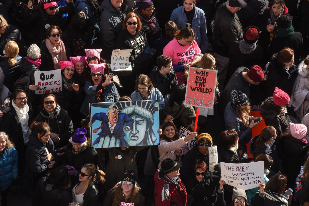 NEW YORK, NY - JANUARY 20: People gather near Central Park before the beginning of the Women's March on January 20, 2018 in New York City. Across the nation hundreds of thousands of people are marching on what is the one-year anniversary of President Donald Trump's swearing-in to protest against his past statements on women and to celebrate women's rights around the world. (Photo by Stephanie Keith/Getty Images)