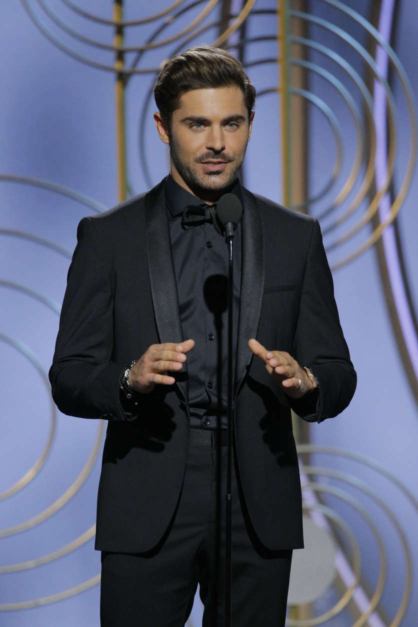 In this handout photo provided by NBCUniversal,  Actor Zac Efron speaks onstage during the 75th Annual Golden Globe Awards at The Beverly Hilton Hotel on January 7, 2018 in Beverly Hills, California.  (Photo by Paul Drinkwater/NBCUniversal via Getty Images)