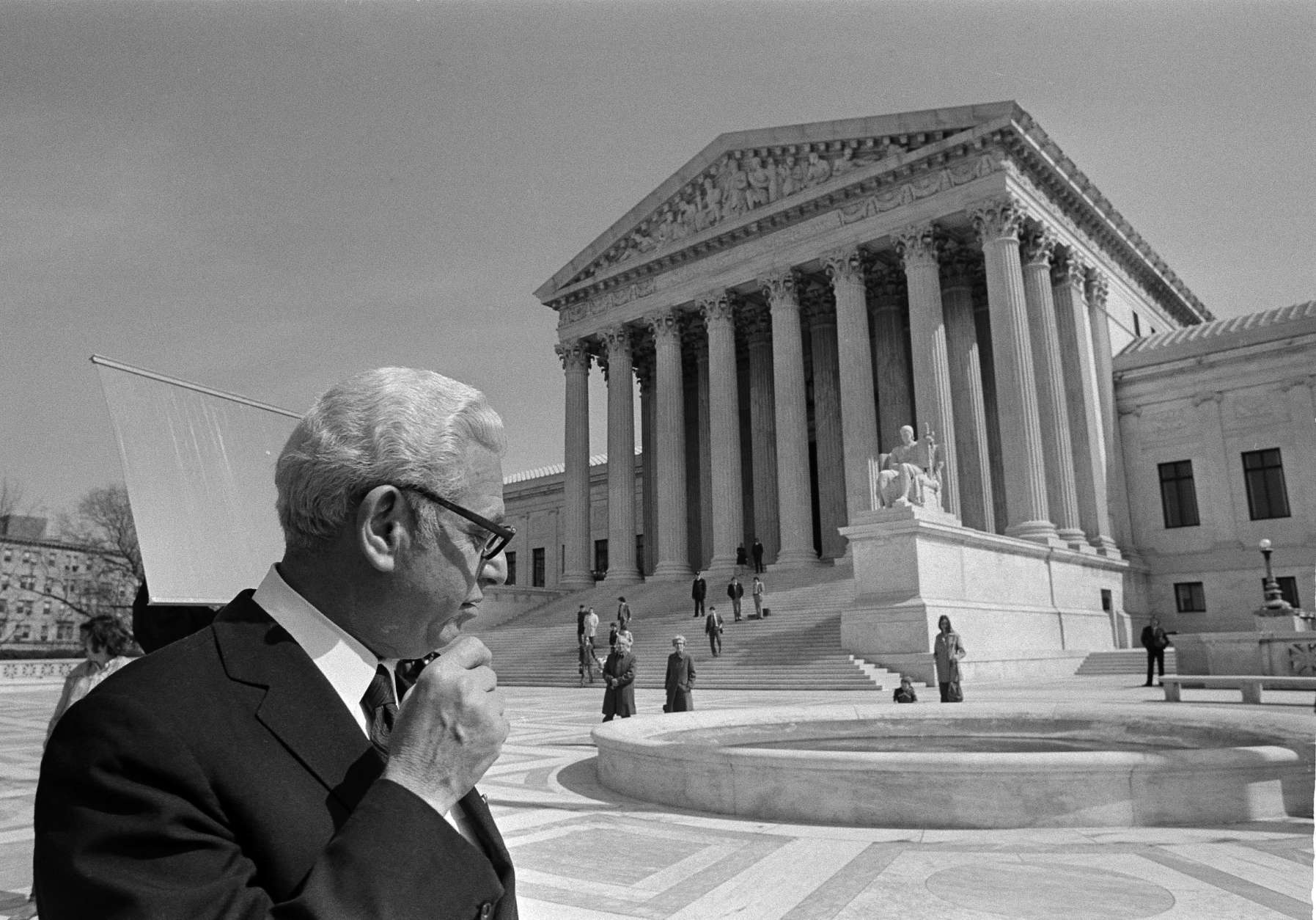 "Arthur Goldberg, former Associate Justice, walks from the Supreme Court building in Washington, D.C., March 20, 1972. Goldberg participated in an hour-long hearing where he urged reversal of a 1922 decision exempting baseball from antitrust laws. Representing former outfielder Curt Flood, who is challenging the reserve clause, Goldberg said the clause is a ""hardcore violation, group boycotting, blacklisting."" (AP Photo/Bob Daugherty)"