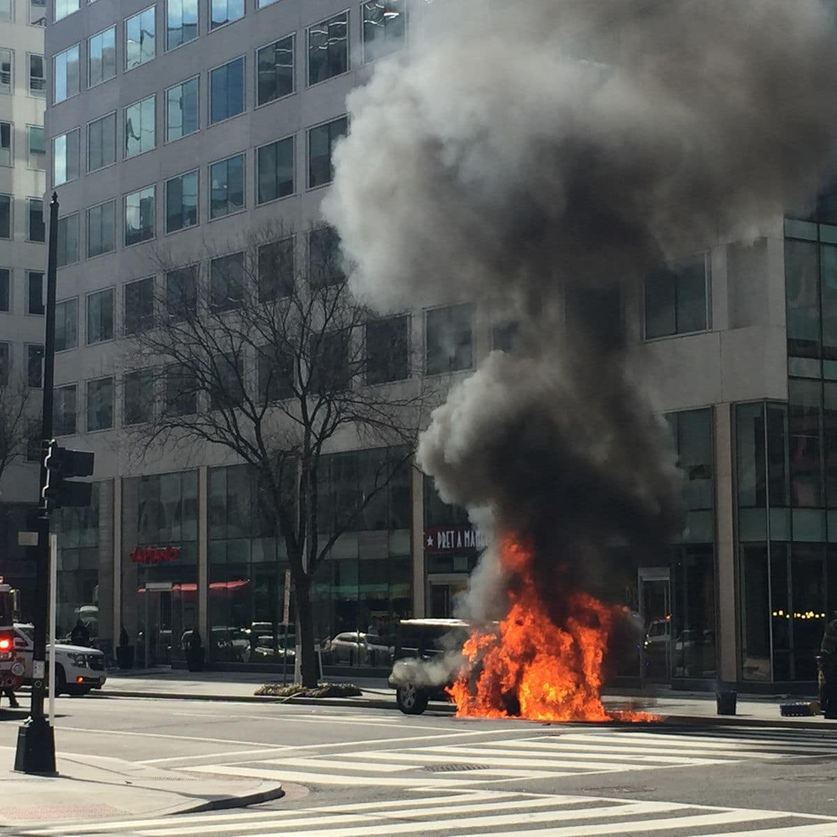 A jeep caught fire in downtown D.C. Tuesday afternoon. (Courtesy Suzanne Raven)