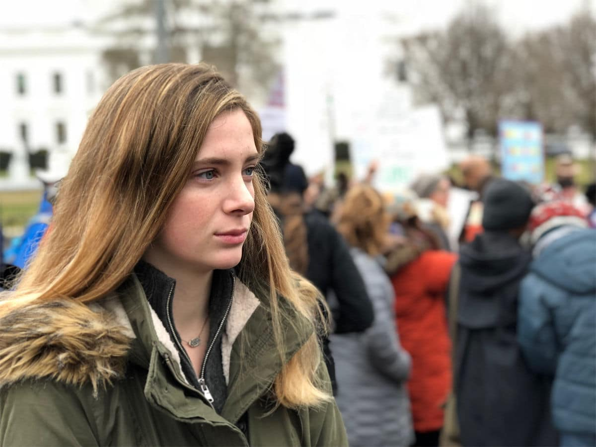 Gigi Aiken, 17, took part in the demonstration at the White House. (WTOP/Kate Ryan)