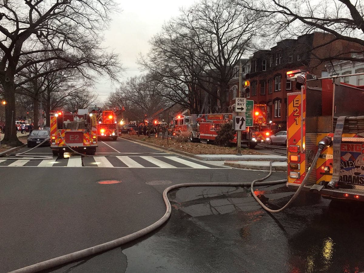 Two people were taken to the hospital after a fire engulfed a three-story town house in Northwest D.C., sending black smoke into the air that was visible for miles. (Courtesy D.C. Fire and EMS)
