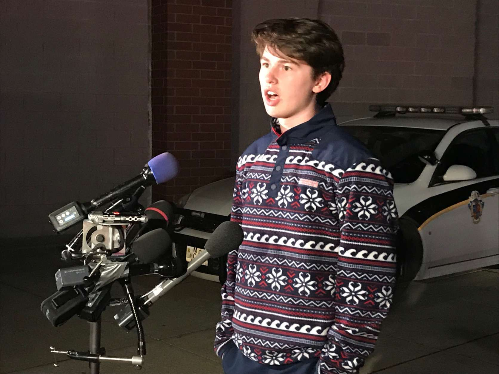 Aidan Kilpatrick, a junior at Einstein High School, speaks Monday night after Parkland, Florida, students met with him and others about school violence. (WTOP/Michelle Basch)