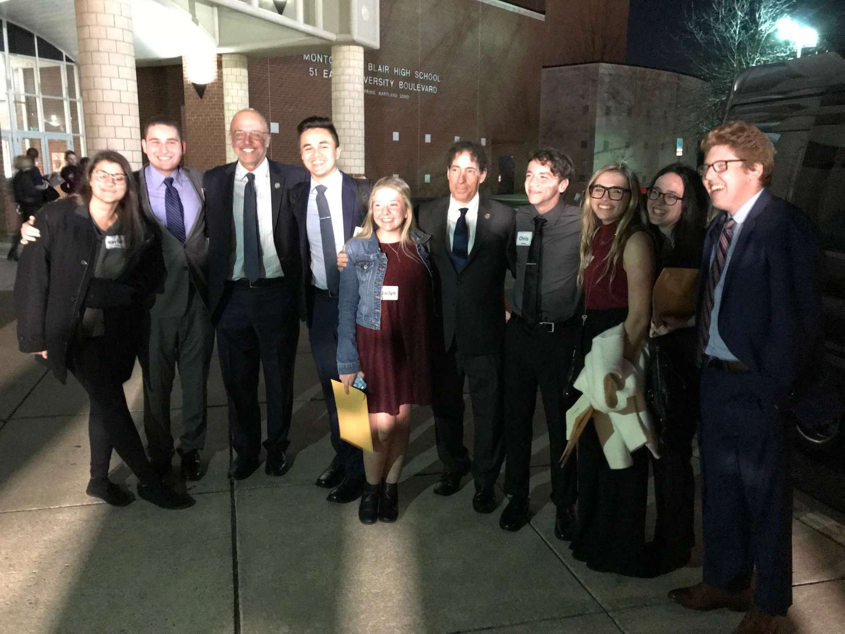 Visiting students from Parkland, FL pose with Congressman Jamie Raskin and others outside Montgomery Blair High School after a discussion with Montgomery County high school students about gun control. (WTOP/Michelle Basch)