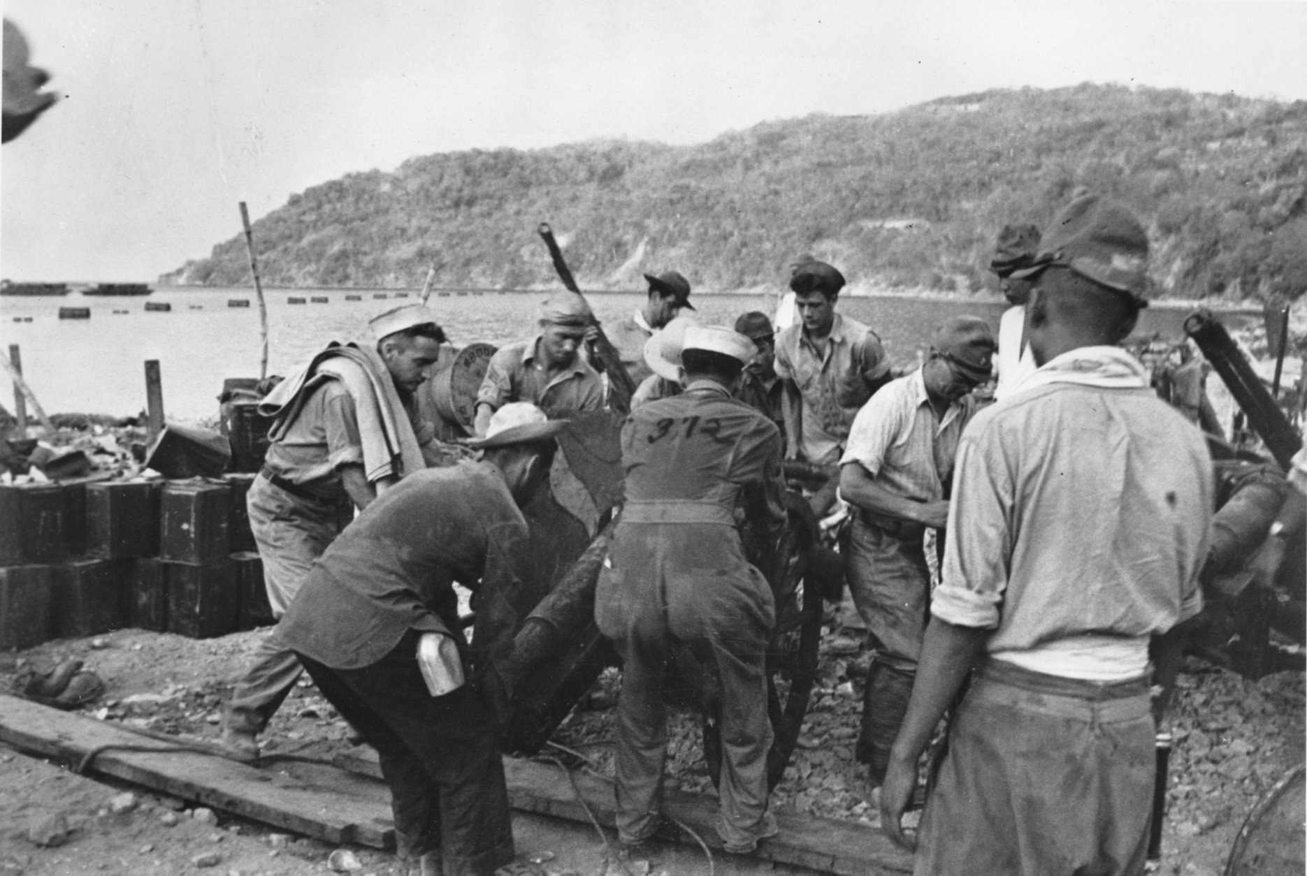 According to the U.S. Army, U.S. Prisoners of War emplace a mountain gun under Japanese guard on the south shore of Corregidor, Philippines. This undated photo was captured from the Japanese during World War II. (AP Photo)