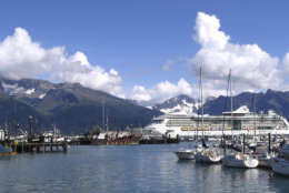 "** FOR STORY SLUGGED CRUCEROS **  Royal Caribbean's ""Radiance of the Seas"" is shown in Seward, Alaska, in this Sept. 7, 2007 photo, dwarfing the fishing boats in the port. (AP Photo/Beth J. Harpaz)"