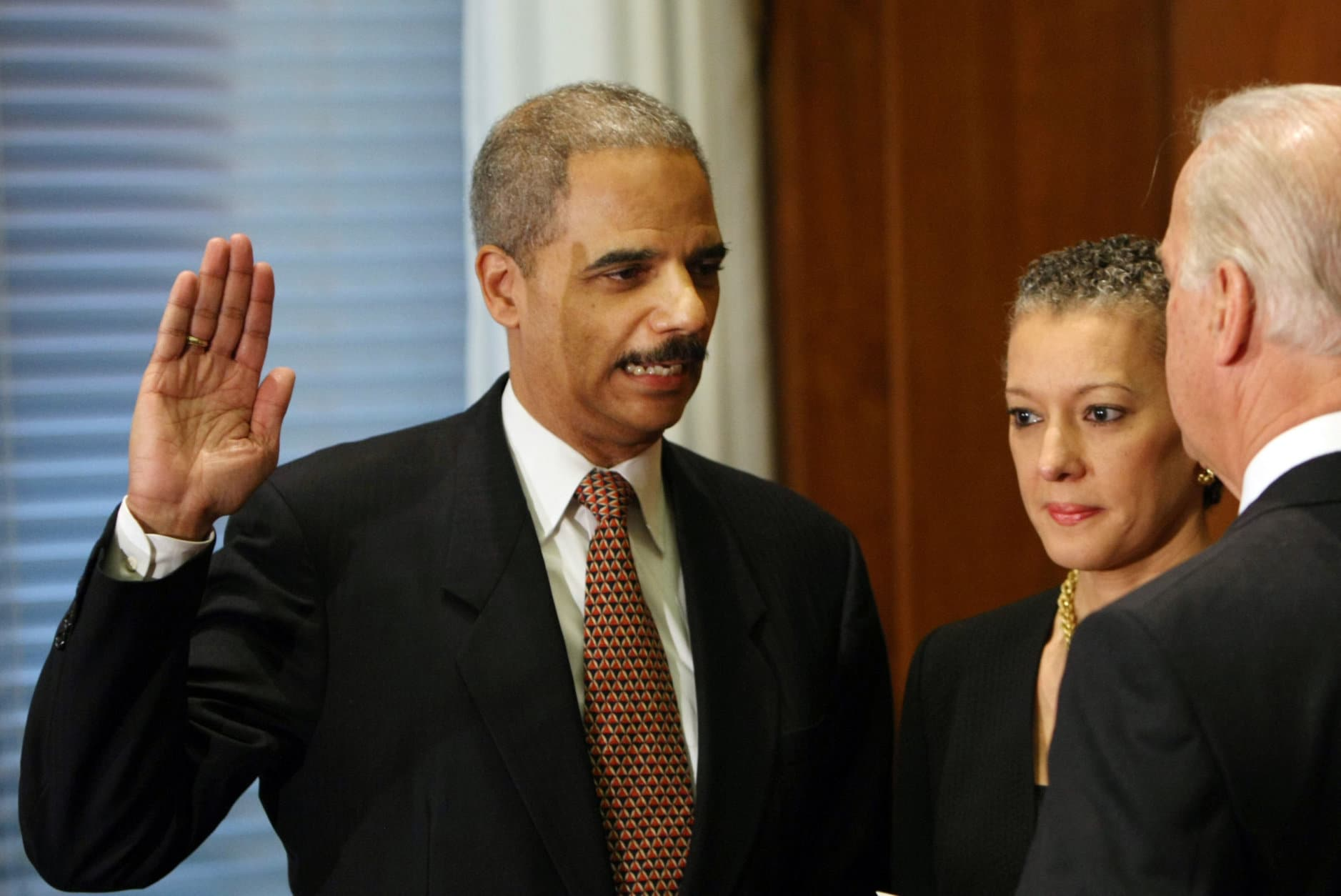 ** RETRANSMISSION FOR ALTERNATE CROP ** Vice President Joseph Biden administers the oath of office to Attorney General Eric Holder during a ceremony at the Justice Department in Washington, Tuesday, Feb. 3, 2009. Holder's wife Sharon Malone is at center. (AP Photo/Gerald Herbert)