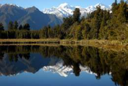 This photo taken June 1, 2009 shows the snow-capped Aoraki, also known as Mount Cook, is reflected in the still waters of Lake Matheson, New Zealand.  Aoraki, part of the Southern Alps, is the highest peak in the Southern Hemisphere. (AP Photo/Kathy Matheson)